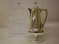 A large sterling silver flagon designed and hand crafted for a new cathedral church in America